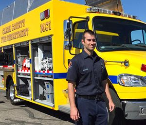 Clark County Fire Department engineer Brian Emery stands by one of his agency's Mass Casualty Incident vehicles in Las Vegas. (AP Photo/Anita Snow)