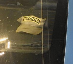 An Anne Arundel police officer has been suspended for displaying a hat bearing the name of a controversial group in the rear windshield of a police cruiser. (Photo/Courtesy)
