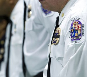 Officers attend the news conference at Prince George's County Police HQ. (AP Image)