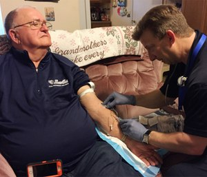 Advanced Practice Paramedic Russ Allen with patient Bill Penrod. (Photo/SCCAD)