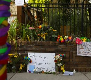 A memorial to aJustine Damond, from Sydney, Australia, who was shot and killed late Saturday by police, is seen Sunday evening, July 16, 2017 in Minneapolis. (Jeff Wheeler/Star Tribune via AP)