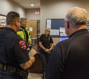 Consider these funding options or encourage your community leaders to fund peer mentoring or other mental health and wellness programs. (Photo/PoliceOne)