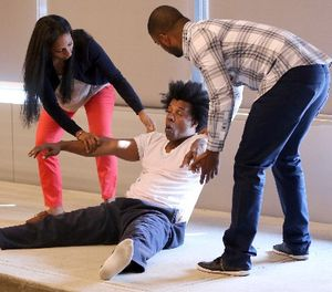 In this Sept. 2, 2015 file photo, officers Danny Lora, right, and Maryan Soliman assist actor Grant Cooper during a Crisis Intervention Training class at the New York Police Department Police Academy, in New York. (AP Photo/Mary Altaffer, File)