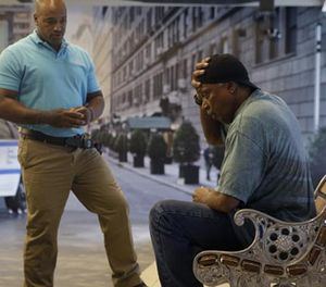 In this Wednesday, Sept. 2, 2015 photo, Officer Lamont Edwards talks to actor Nathan Purdee during a Crisis Intervention Training class at the New York Police Department Police Academy, in New York. (AP Photo/Mary Altaffer)