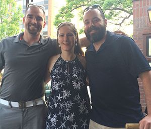 Koch, one year after her injury, celebrates with paramedics Carter Nevill and Luke Tallman, who saved her life.