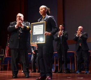 Capitol Hill Police Chief Matthew Verdarosa, left, presents Capitol Hill police special agent Crystal Griner, second from left, with a Medal of Honor during a ceremony on Capitol Hill in Washington, Thursday, Nov. 9, 2017. (AP Photo/Susan Walsh)