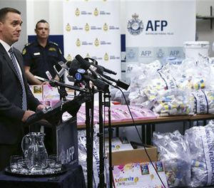 Commander Chris Sheehan from the Australian Federal Police stands by a display of confiscated drugs in Sydney, Monday, Jan. 15, 2016. (AP Image)