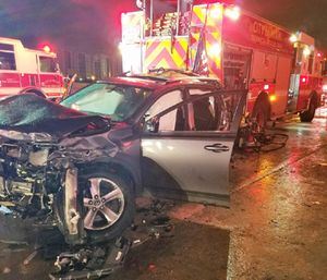 Two firefighters were struck Saturday while responding to a crash. (Miami Fire Rescue)