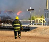 Officials: Fire at Mich. mulch facility could burn a week