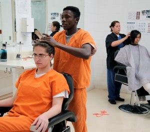 Immigration detainees using a beauty salon that has been set up at a dedicated unit for transgender women in the Cibola County Correctional Center in Milan, N.M. (Ron Rogers/U.S. Immigration and Customs Enforcement via AP)
