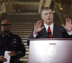 Dallas mayor Mike Rawlings, left , and Dallas police chief David Brown, right, during a news conference, Friday, July 8, 2016, in Dallas. (AP Photo/Eric Gay)