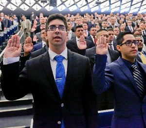 New York Police Department (NYPD) recruits raise their right hands in a pledge during a swearing-in ceremony for new recruits at the Police Academy, Thursday, July 6, 2017, in New York. (AP Photo/Bebeto Matthews)