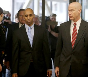 Former Minneapolis police officer Mohamed Noor walks through the skyway with his attorney Thomas Plunkett, right, on the way to court for the verdict Tuesday, April 30, 2019, in Minneapolis, Minn. (David Joles/Star Tribune via AP)