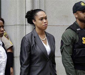Baltimore state's attorney Marilyn Mosby, center, leaves a courthouse after Officer Caesar Goodson, one of six Baltimore city police officers charged in connection to the death of Freddie Gray, was acquitted of all charges in his trial in Baltimore, Thursday, June 23, 2016. (AP Photo/Patrick Semansky)