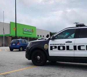 Springfield police respond to a Walmart in Springfield, Mo., Thursday afternoon, Aug. 8, 2019, after reports of a man with a weapon in the store. (Harrison Keegan/The Springfield News-Leader via AP)
