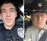 Miss. city holds vigil for 2 officers killed in shootout