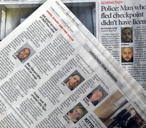 This Monday, Feb. 11, 2019, photo shows a view of published New York state newspapers showing police mug shots of arrested people in Albany, N.Y. New York's governor doesn't want state police to routinely release mug shots of criminal suspects, or arrest booking records about exactly what they are accused of doing.