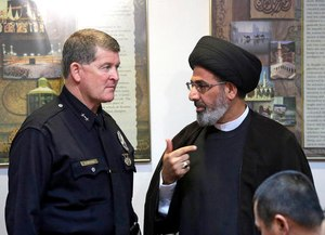 Los Angeles Police Deputy Chief Michael Downing talks with Sayed Moustafa al-Qazwini, founding Imam of the Islamic Educational Center of Orange County at a news conference at the Islamic Center of Southern California in Los Angeles Monday, Nov. 28, 2016. (AP Photo/Nick Ut)