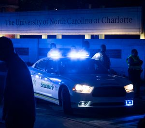 Police secure the main entrance to UNC Charlotte after a fatal shooting at the school, Tuesday, April 30, 2019, in Charlotte, N.C. (AP Photo/Jason E. Miczek)