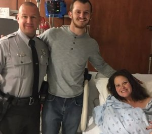 Parents Jimmy and Laura Baker could no longer make it to the hospital, so Sgt. Brian Maynard assisted in the birth.