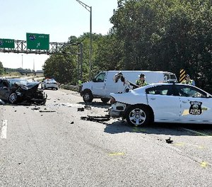 This photo provided by the Indiana State Police shows the aftermath of a crash along Interstate 865 near Zionsville, Ind., Wednesday, Aug. 30, 2017. (John Perrine/Indiana State Police via AP)