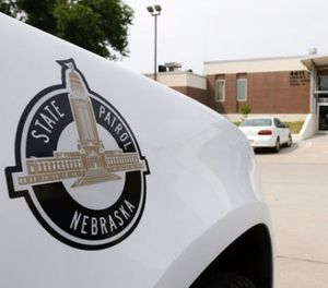 A vehicle with the Nebraska State Patrol logo is parked in a state patrol facility in Omaha, Neb., Wednesday, Aug. 2, 2017. (AP Photo/Nati Harnik)