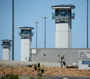 In this April 15, 2015 file photo guard towers are seen at High Desert State Prison in Indian Springs, Nev. (AP Photo/John Locher,File)