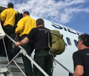 New Zealand firefighters board a plane to head to the Western U.S. to help with wildfire aid. (Photo/NIFC)