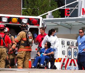Emergency responders work to transfer staff members from Exeter Hospital to other Seacoast hospitals. (Rich Beauchesne/Portsmouth Herald via AP)