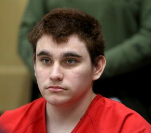 In this Aug. 15, 2018 file photo, Florida school shooting suspect Nikolas Cruz listens during a status check on his case at the Broward County Courthouse in Fort Lauderdale, Fla. Authorities say Cruz attacked a detention officer at the county jail, Tuesday, Nov. 13, and now faces new charges. Cruz is charged with killing 17 people and wounding 17 others in the Feb. 14 mass shooting at Marjory Stoneman Douglas High School. (Amy Beth Bennett/South Florida Sun-Sentinel via AP, Pool, File)