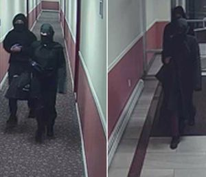 Suspects were covered from head to toe in black and casually walked through the Cherry Park apartments. (Photo/Newark Police Department)