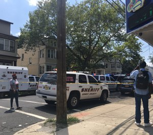A heavy police presence along Myrtle Avenue after a police officer was shot on Thursday, Aug. 8, 2019. The officer suffered injuries not considered life-threatening. (Photo/Karen Yi | NJ Advance Media for NJ.com)