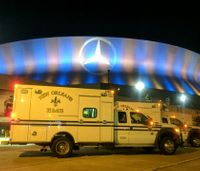Mercedes-Benz Superdome lit blue and gold in honor of EMS Week