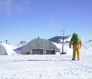 A firefighter returns to the South Pole dome after responding to a false alarm. (Photo/Kristan Hutchison with the National Science Foundation)