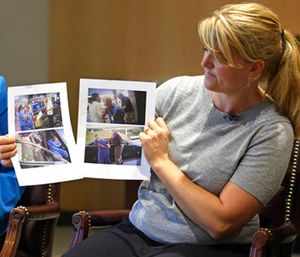 Nurse Alex Wubbels, right, displays video frame grabs of herself being taken into custody. (AP Photo/Rick Bowmer)