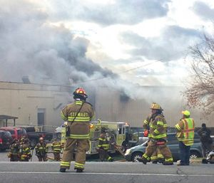 Firefighters work at the scene of of a fire Monday, Nov. 20, 2017, at the Verla International cosmetics factory on Temple Hill Road in New Windsor, NY. (Allyse Pulliam/Times Herald-Record via AP)