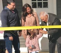 NY cop who lost legs as a Marine receives new home