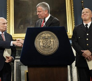 New York City Mayor Bill de Blasio, center, is joined by Police Commissioner William Bratton, left, and Chief of Department James O'Neill during a news conference, Tuesday, Aug. 2, 2016, in New York's City Hall. (AP Photo/Mary Altaffer)