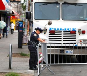 A police officer works near the site where an officer was killed in the Bronx section of New York, Thursday, July 6, 2017. (AP Photo/Seth Wenig)