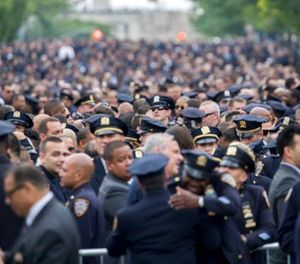 Police officers congregate for the funeral service for slain New York City police officer Miosotis Familia, Tuesday, July 11, 2017, at the World Changers Church in the Bronx borough of New York. (AP Photo/Mary Altaffer)