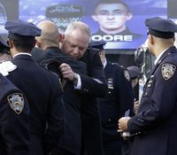 At NYPD officer's funeral, police reflect on tough time