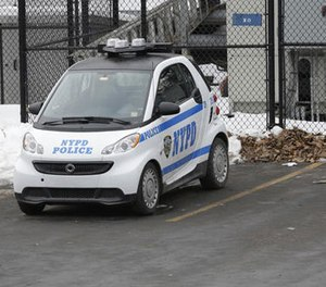 In this Feb. 12, 2015 file photo, A New York City Police Department Smart car is parked in the parking lot of Central Park's precinct in New York. (AP Photo/Mary Altaffer)