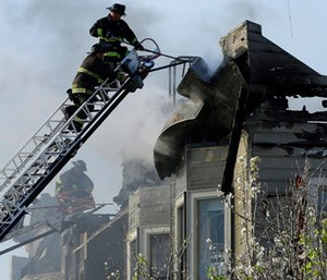 Firefighters battle an early morning apartment fire Monday in Oakland, Calif. (AP Photo/Ben Margot)