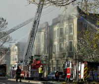 Oakland officials: Candle ignited fire that killed 4