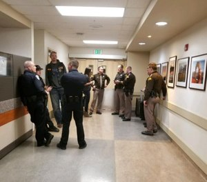 Law enforcement from Montana and Utah watch over Trooper Wade Palmer's room (Photo/ Montana Highway Patrol via Facebook)