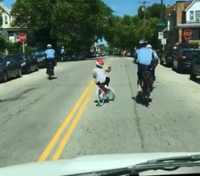 Video: Philly police officers help girl ride bike
