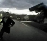 Video: Ohio cop refuses to shoot murder suspect charging at him
