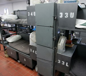 In this Monday, May 10, 2010, inmates in unit four of the John Lilley Correctional Center in Boley, Okla., are housed in a building originally built as a dining facility. Shown here are the bunk beds and limited storage space allocated to each inmate. Oklahoma has the nation's highest incarceration rate, overcrowded prisons and skyrocketing costs. (AP Photo/Sue Ogrocki, File)