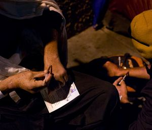 Two homeless drug addicts inject themselves with heroin in the Skid Row area of downtown Los Angeles. (AP Photo/Jae C. Hong)