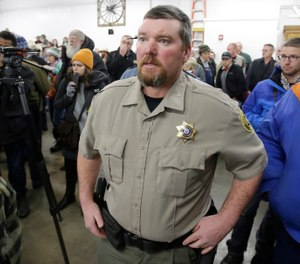 In this Jan. 6, 2016, file photo, Harney County Sheriff David Ward arrives at a community meeting at the Harney County fairgrounds in Burns, Ore. (AP Photo/Rick Bowmer, File)